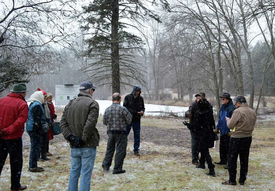 Opponents of a plan to develop 21 homes on a tract known as the White Barn property, situated at the town's border with Norwalk, gathered for a press conference Tuesday on abutting open space to draw attention to their concerns. Photo: Jarret Liotta / Westport News