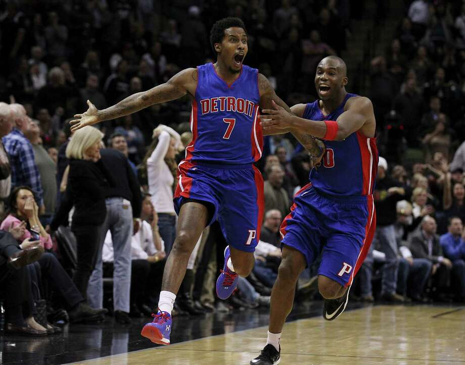 Detroit Pistons' Brandon Jennings celebrates with teammate Jodie Meeks after Jennings made the game-winning shot against the Spurs at the AT&T Center. Spurs lose to the Pistons, 104-105. Photo: Kin Man Hui /San Antonio Express-News / ©2015 San Antonio Express-News