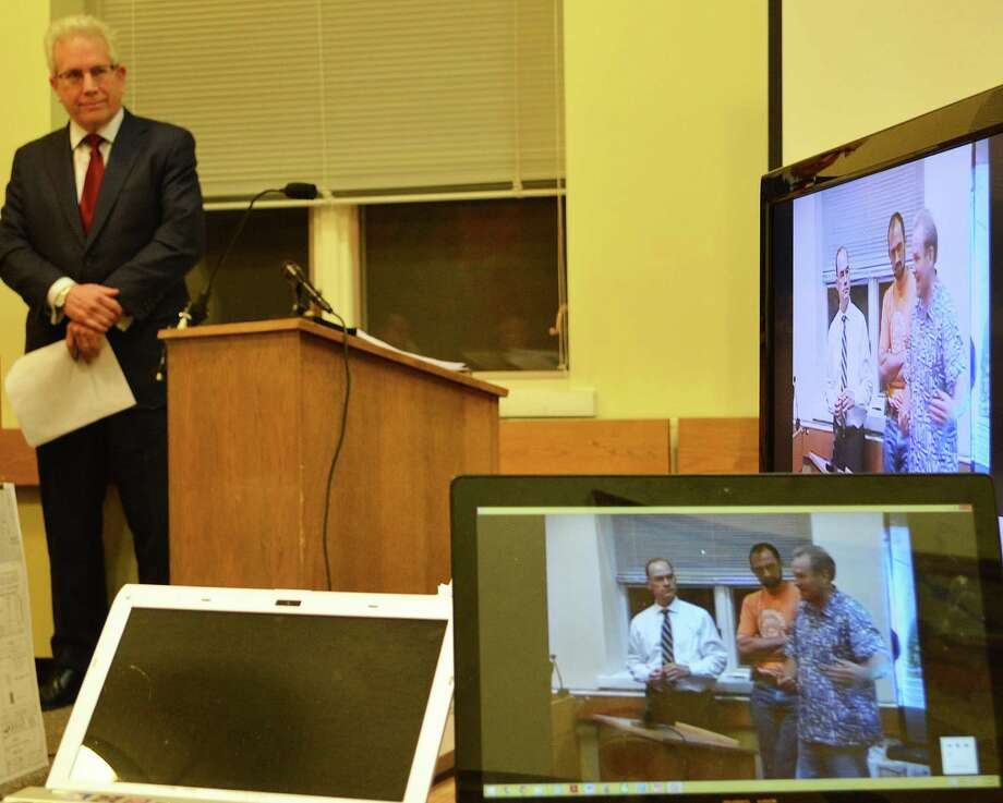 Wilder Gleason, a lawyer representing neighbors of the Kensett housing development, shows the Planning and Zoning Commission a video of 2007 P&Z meetings at which the developers made promises that he said have not been kept. Photo: Jarret Liotta / Darien News