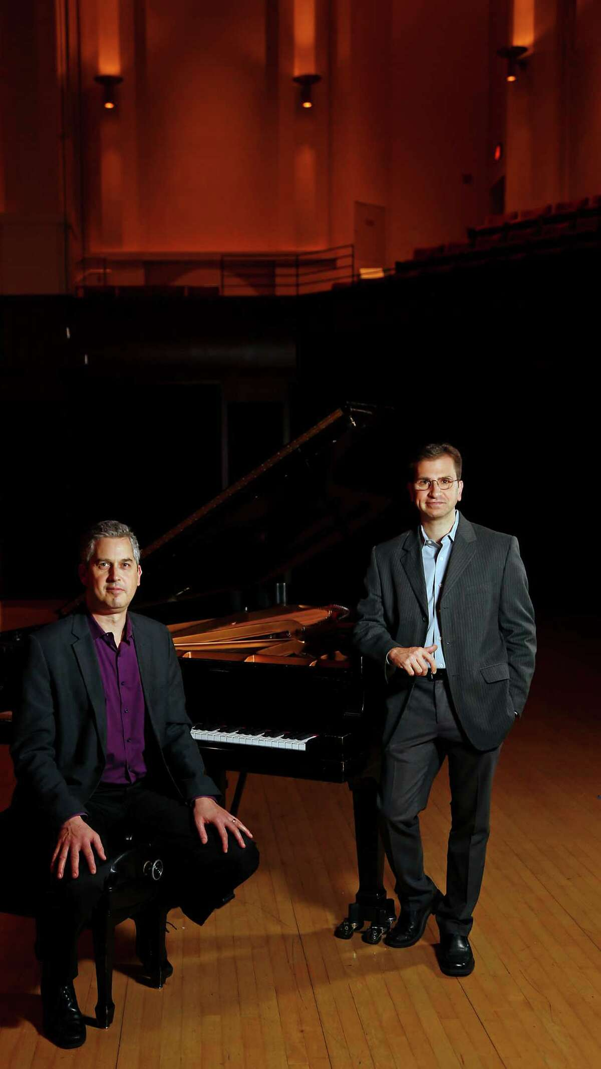 Anthony Brandt left, and Karim Al-Zand right, poses for a portrait at Rice University Wednesday, Dec. 24, 2014, in Houston. Brandt and Al-Zand are Houston composers who have written new pieces that will premiere Jan. 10 in a concert by the Musiqa new-music group. ( James Nielsen / Houston Chronicle )