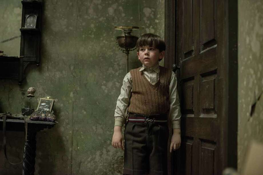 """Little Edward (Oaklee Pendergast) was so traumatized by the bombing that killed his parents that he won't speak. He just draws creepy pencil sketches, which shows us  that someone is after the boy in """"The Woman in Black 2: Angel of Death."""" Photo: Relativity Media / ONLINE_YES"""