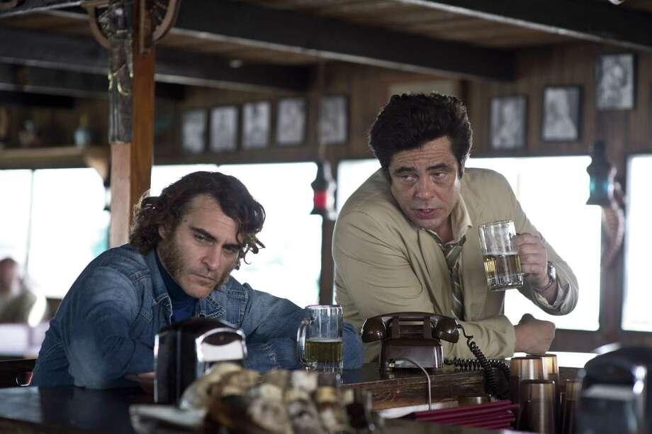 "Joaquin Phoenix, left, and Benicio Del Toro star in ""Inherent Vice."" Photo: Wilson Webb, Unit Photographer / ONLINE_YES"