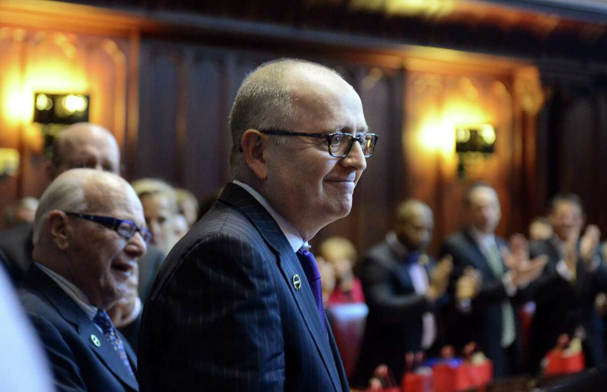 State Sen. Andrew Maynard, D-Stonington, injured in a fall in July, returned to the Senate on the opening day of legislature Wednesday, Wednesday, Jan. 7, 2015, in the state Senate chamber in Hartford, Conn.