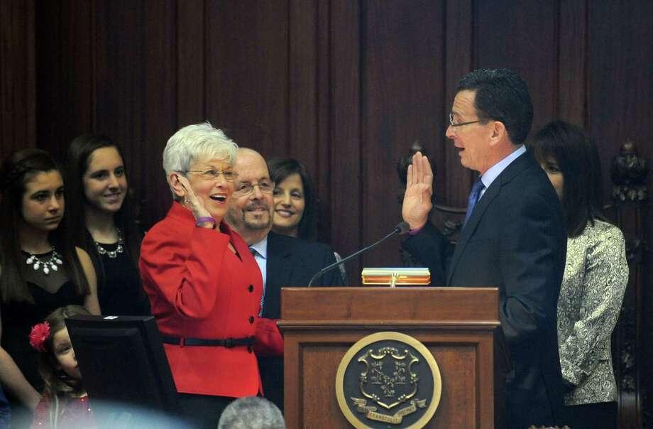 Gov. Dannel Malloy swears in Lt. Gov. Nancy Wyman Wednesday, Jan. 7, 2015, in the state Senate chamber in Hartford, Conn. Photo: Autumn Driscoll / Connecticut Post