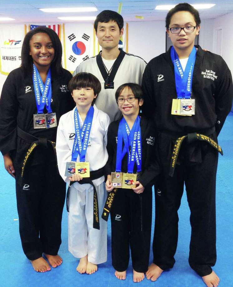 Among those representing Hong's Olympic Taekwondo Academy at the 10th American Taekwondo Championship at Queens College in Flushing, NY. Nov. 8, 2014  Courtesy of Hong's Olympic Taekwondo Academy Photo: Contributed Photo / The News-Times Contributed