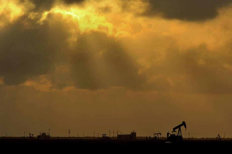 The sun sets over several oil pumps on High Island Tuesday evening. Guiseppe Barranco/The Enterprise / Beaumont
