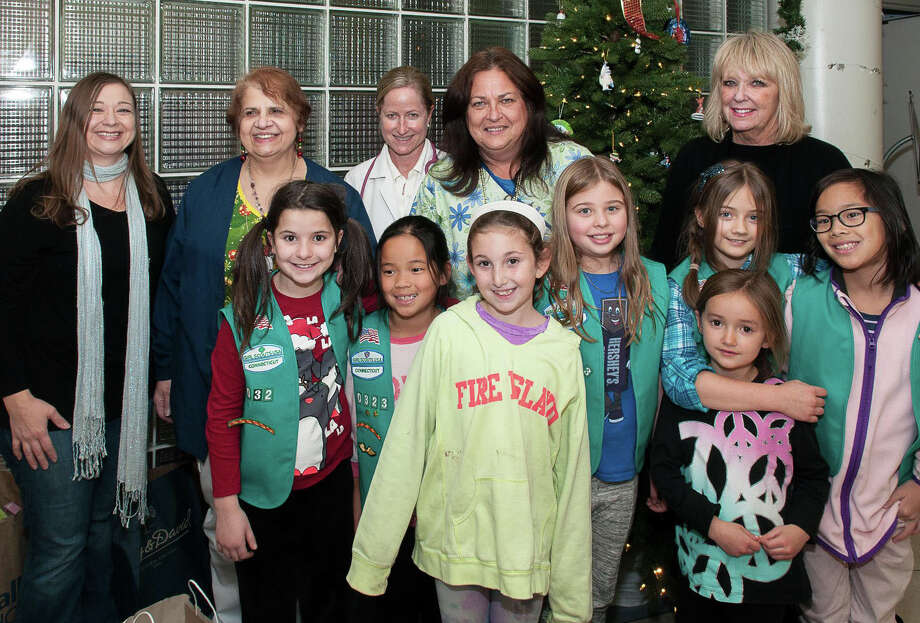 Girl Scout Juniors from Weston, Conn., recently made a visit to Norwalk Hospital to spread some cheer and donate some toys, games and other items to patients in the pediatric unit. Those in attendance during the visit included, from left, back row, Edina Field, Madeline Eicas, RN, Dr. Alicia Briggs, Lorraine Robinson, RN and Jan Mola; middle row, Natalye Lustberg, Mia Sciarretta, Stephanie Field, Madeline Lawler and Catherine Frances; front row, Addison Berch and Sarah Lawler. Photo: Contributed Photo / Stamford Advocate Contributed photo