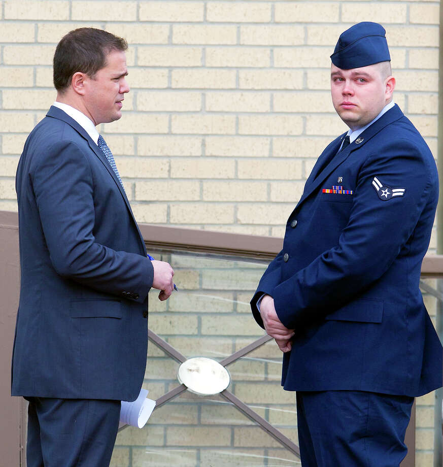 Airman 1st Class Michael Lightsey speaks with his civilian attorney Jeffrey King Wednesday Jan. 7, 2015, outside the 37th Training Wing Headquarters at Joint Base San Antonio-Lackland before being found guilty of sexually assaulting a woman as she was coming out from anesthesia after an out-patient surgery at Wilford Hall. Photo: William Luther, San Antonio Express-News / © 2015 San Antonio Express-News