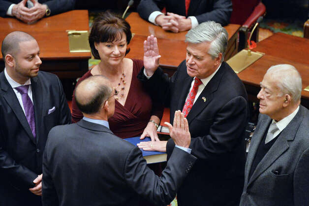 NYS Senate GOP leader Dean Skelos, second from right, is joined by his father Basil, right,wife Gail, center, and his son Adam, left, as he is sworn in by his brother Judge Peter Skelos during a ceremony in the Senate Wednesday Jan. 7, 2015, in Albany, NY.  (John Carl D'Annibale / Times Union) Photo: John Carl D'Annibale, Albany Times Union / 00030091A