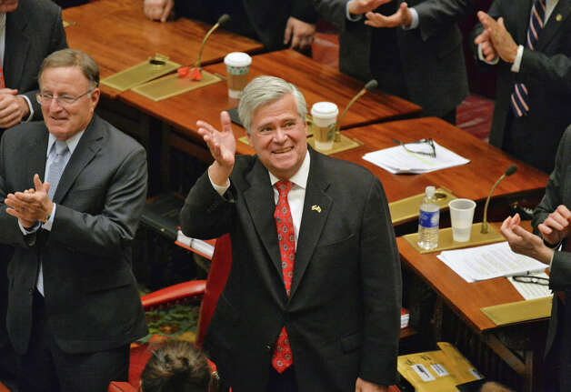 NYS Senate GOP leader Dean Skelos, center, waves to supporters after being sworn in during a ceremony in the Senate Wednesday Jan. 7, 2015, in Albany, NY.  (John Carl D'Annibale / Times Union) Photo: John Carl D'Annibale, Albany Times Union / 00030091A