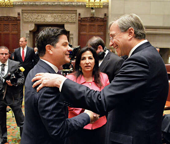 New NYS Senators George Amedore, left, and Diane Savino with NYS GOP Chairman Ed Cox, right, during swearing in ceremonies in the Senate Wednesday Jan. 7, 2015, in Albany, NY.  (John Carl D'Annibale / Times Union) Photo: John Carl D'Annibale, Albany Times Union / 00030091A