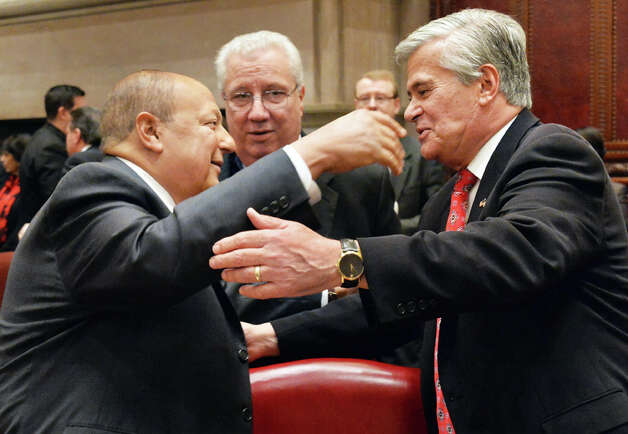 NYS Senator Tom Libous, left, and GOP leader Dean Skelos embrace during the NYS Senate's first session of the new year Wednesday Jan. 7, 2015, in Albany, NY.  At center is NYS Senator Carl Marcellino. (John Carl D'Annibale / Times Union) Photo: John Carl D'Annibale, Albany Times Union / 00030091A