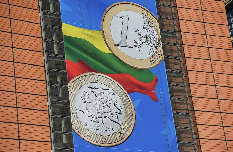 A banner welcomes Lithuania, the eurozone's 19th member. It began switched its currency this year, 10 years after joining the European Union. Photo: EMMANUEL DUNAND / AFP/Getty Images / AFP