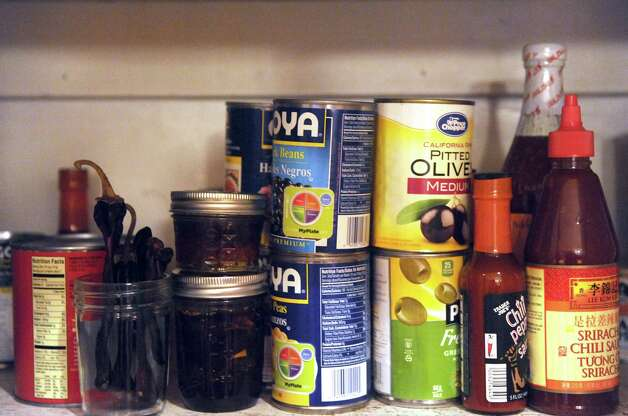 Items in the pantry of Caroline Barrett's house on Tuesday Dec. 23, 2014 in Delmar, N.Y. (Michael P. Farrell/Times Union) Photo: Michael P. Farrell / 00029882A