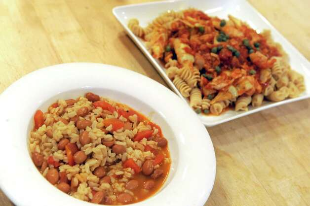 Rice and beans with roasted red peppers, left, and pasta with tuna, artichokes and capers on Tuesday Dec. 23, 2014 in Delmar, N.Y. (Michael P. Farrell/Times Union) Photo: Michael P. Farrell / 00029882A