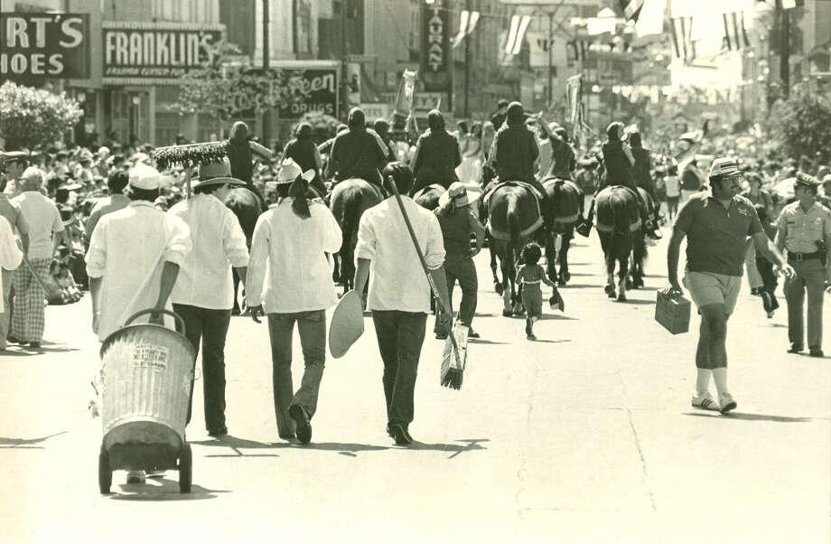 1. The Super Scooper Brigade began during the 1973-1974 Fiesta season. Photo: EXPRESS-NEWS FILE PHOTO