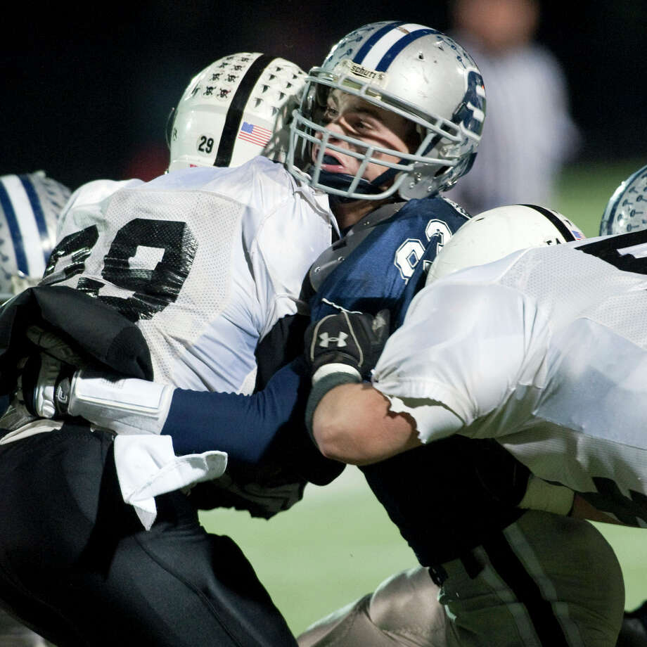 Chris Coyne, playing football for Westport's Staples High School during a playoff game on Dec. 1, 2009. Coyne, a senior at Yale University suffered multiple concussions. The last one, at Yale, ended his playing career. Photo: File Photo / Connecticut Post File Photo