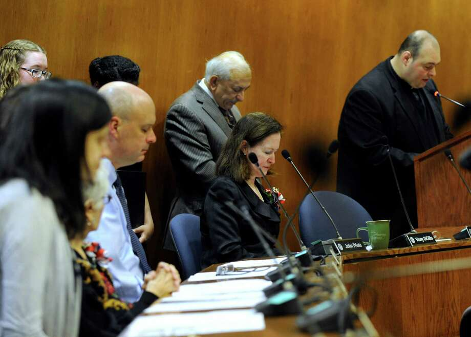 Father Naji J. Kiwan, of St. Anthony's Maronite Roman Catholic Church in Danbury, gives the invocation at a swearing-in ceremony for Probate Judge Dianne Yamin, at Danbury City Hall, Wed., January 7, 2015. Photo: Carol Kaliff / The News-Times