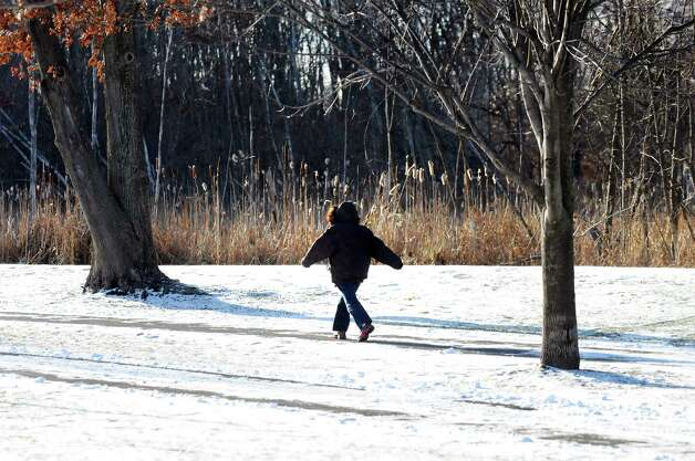 A brave soul takes a brisk walk in the cold on Wednesday, Jan. 7, 2015, at The Crossings in Colonie, N.Y. (Cindy Schultz / Times Union) Photo: Cindy Schultz / 00030108A