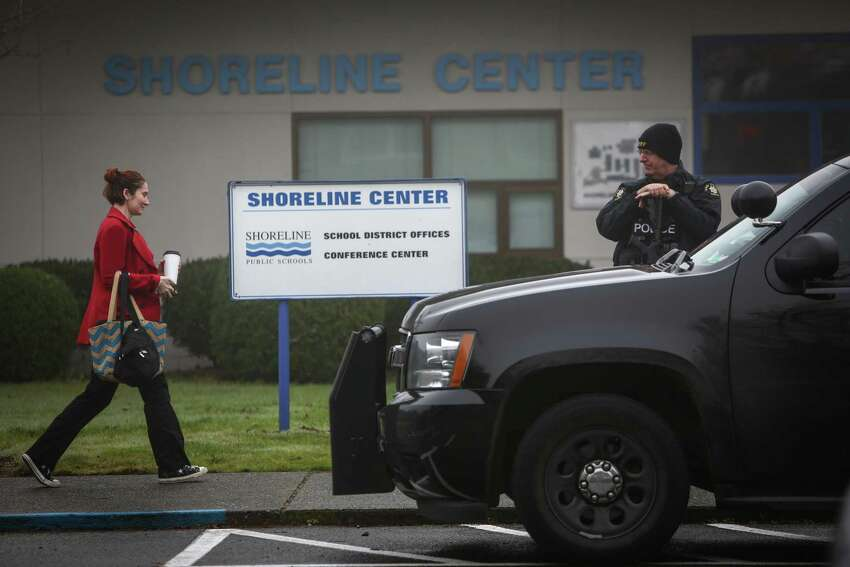 Parents arrive to pick up their children after a man with a gun was seen at nearby Meridian Park School in Shoreline on Wednesday, January 7, 2015. An employee of the school said the man threatened the school, prompting the closure of schools across the district.
