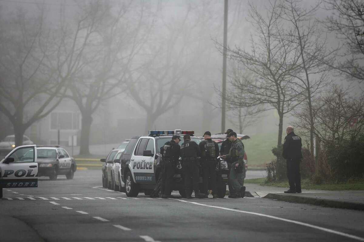 Officers converge on Meridian Park School after a man with a gun was seen at Meridian Park School in Shoreline on Wednesday, January 7, 2015. An employee of the school said the man threatened the school, prompting the closure of schools across the district.
