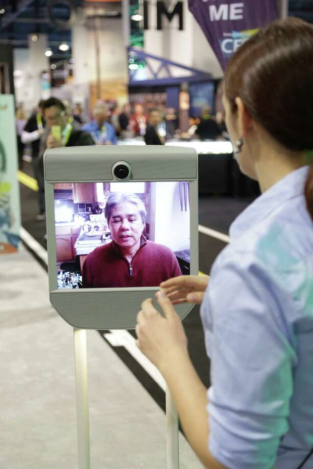 Benny Evangelista uses a Beam Pro telepresence robot by Suitable Technologies to get a look at CES. Photo: Ryan Wood / Suitable Technologies / ONLINE_YES