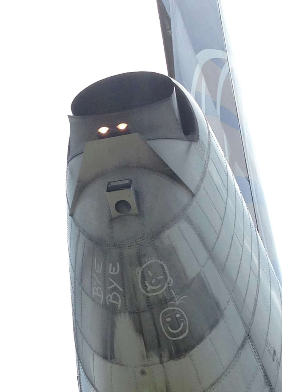 A crew member's photo provided with the complaint shows the writing and images on the United Airlines jet at SFO.