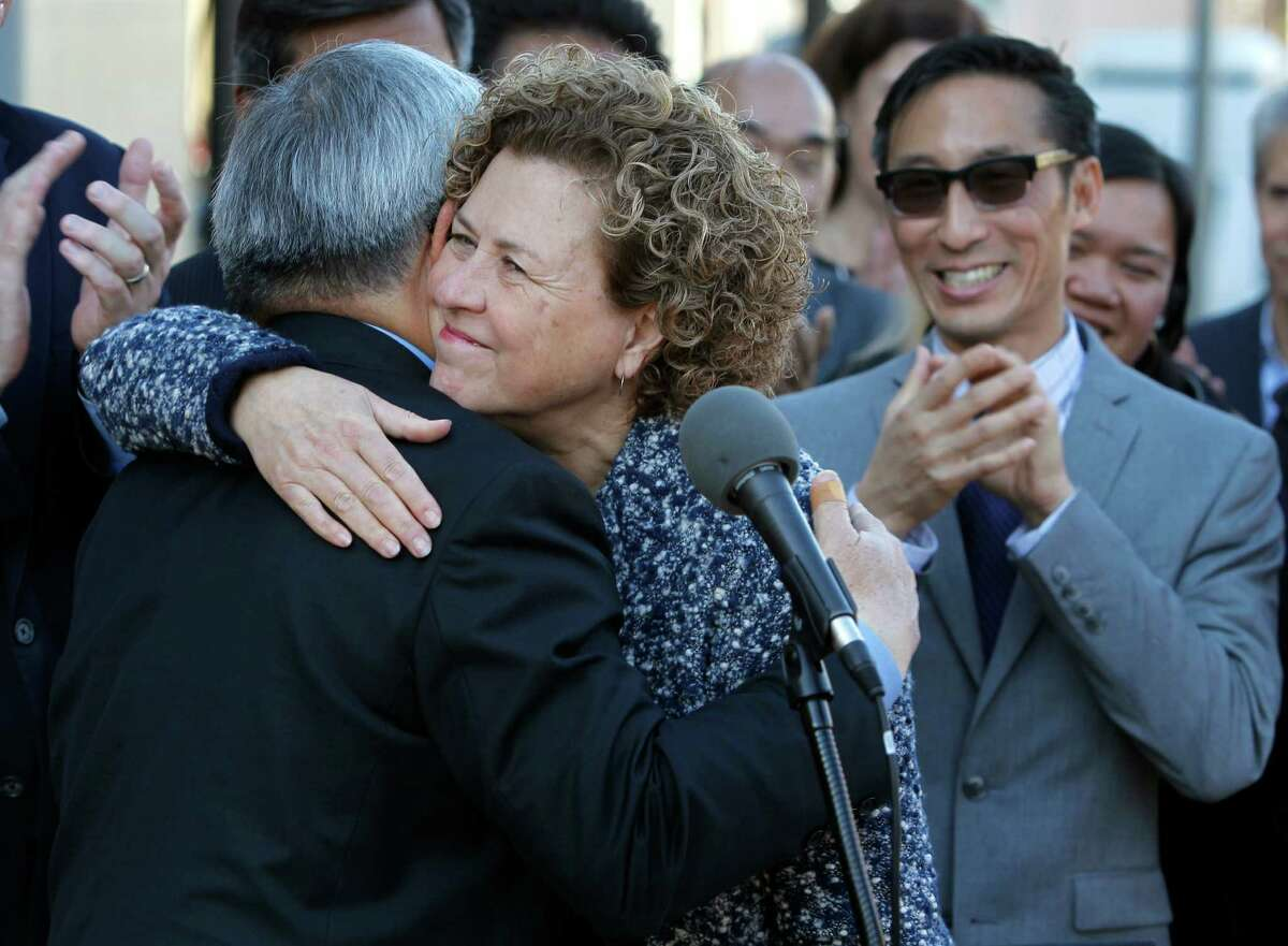 Mayor Ed Lee appoints Julie Christensen to fill the vacant District 3 seat on the Board of Supervisors in San Francisco, Calif. on Wednesday, Jan 7, 2015. Supervisor Eric Mar (right) applauds. Christensen takes over from David Chiu, who was elected to the state assembly in November.