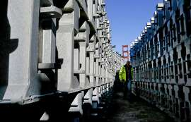 The movable barriers weighing 1,500 pounds each are stacked and ready for installation as seen on Wednesday Jan. 7, 2015, in San Francisco, Calif., as preparations are made for the installation of the entire zipper barrier system on the Golden Gate Bridge this coming weekend.
