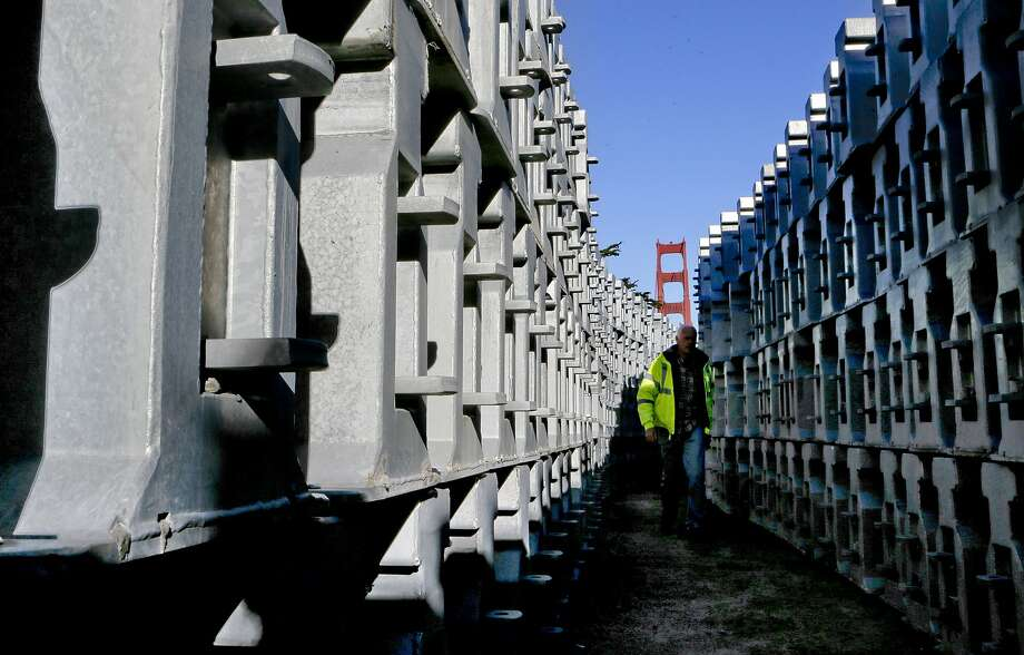 The movable barriers weighing 1,500 pounds each are stacked and ready for installation as seen on Wednesday Jan. 7, 2015, in San Francisco, Calif., as preparations are made for the installation of the entire zipper barrier system on the Golden Gate Bridge this coming weekend. Photo: Michael Macor, The Chronicle