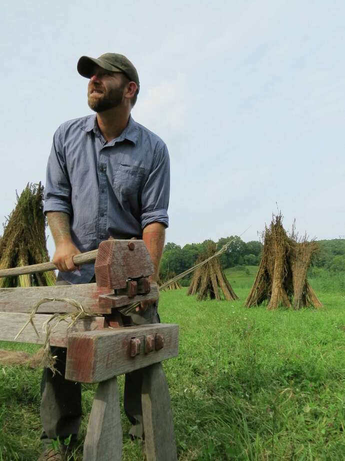 Farmer and military veteran Mike Lewis processes hemp stalks on an old- fashioned wood brake in Mount Vernon, Ky. The Farm Bill pilot program, an agricultural education curriculum for vets, was sponsored by Growing Warriors. Photo: Hemp Industries Association / ONLINE_YES