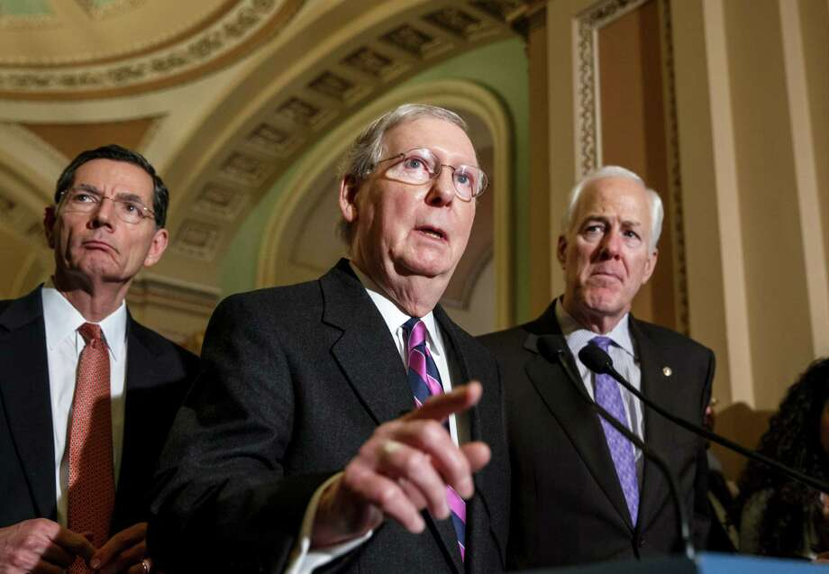 Senate Majority Leader Mitch McConnell, R-Ky., flanked by Sen. John Barrasso, R-Wyo., (left) and Senate Majority Whip John Cornyn, R-Texas, talks with reporters after their first GOP policy meeting since Congress reconvened Tuesday, at the Capitol in Washington. With Congress under full GOP control for the first time in eight years, Republicans are pursuing an ambitious agenda including early votes on bills to advance the long-stalled Keystone XL pipeline and change the definition of full-time work under President Obama's health law from 30 hours a week to 40 hours a week. Obama has threatened to veto both measures. Photo: J. Scott Applewhite / Associated Press / AP