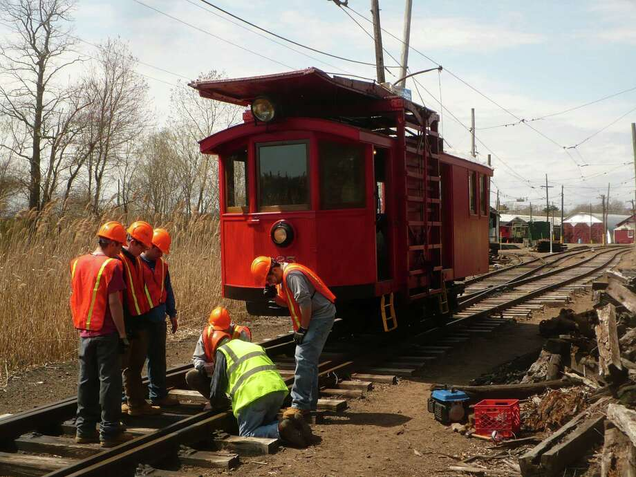 Volunteers and engineering students work on the tracks at the Shore Line Trolley Museum, a National Historic District, in East Haven. Photo: Contributed Photo / Connecticut Post Contributed