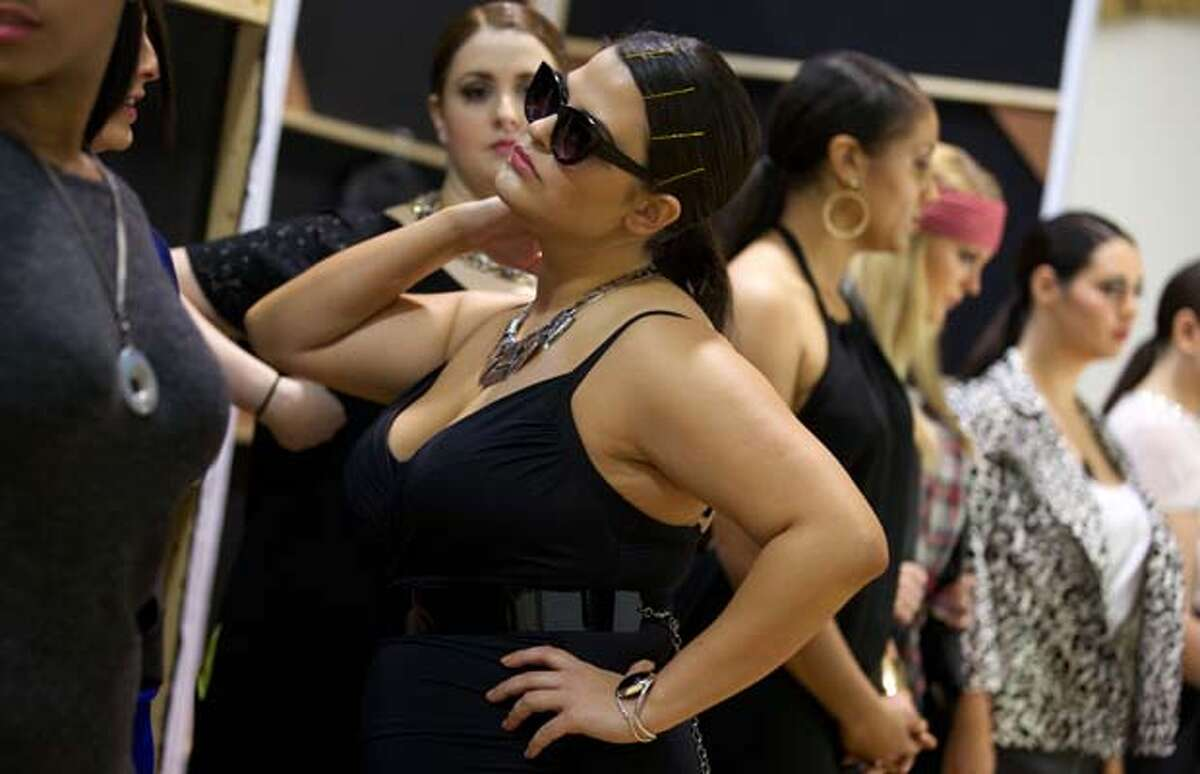 Models are photographed back stage at the British Plus Size Fashion Weekend in London