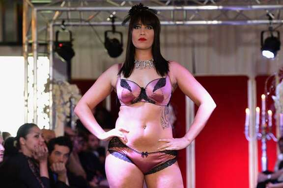 A model  presents plus-size lingerie during the Pulp fashion show in Paris on November 28, 2014. AFP PHOTO / BERTRAND GUAY