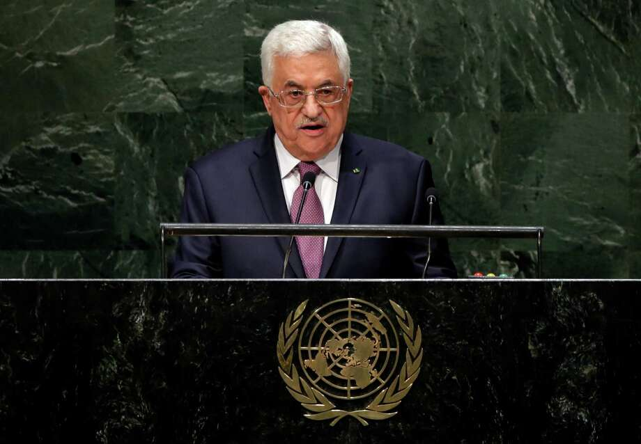 FILE - In this Friday, Sept. 26, 2014, file photo, Palestinian President Mahmoud Abbas addresses the 69th session of the United Nations General Assembly at U.N. headquarters. The U.N. has accepted Palestine's request join the International Criminal Court, setting April 1 as the starting date and clearing the way for potential war crimes investigations of Israel over its settlement building on occupied lands and a 2014 war in Gaza that killed hundreds of civilians.  (AP Photo/Richard Drew, File) Photo: Richard Drew / Associated Press / AP