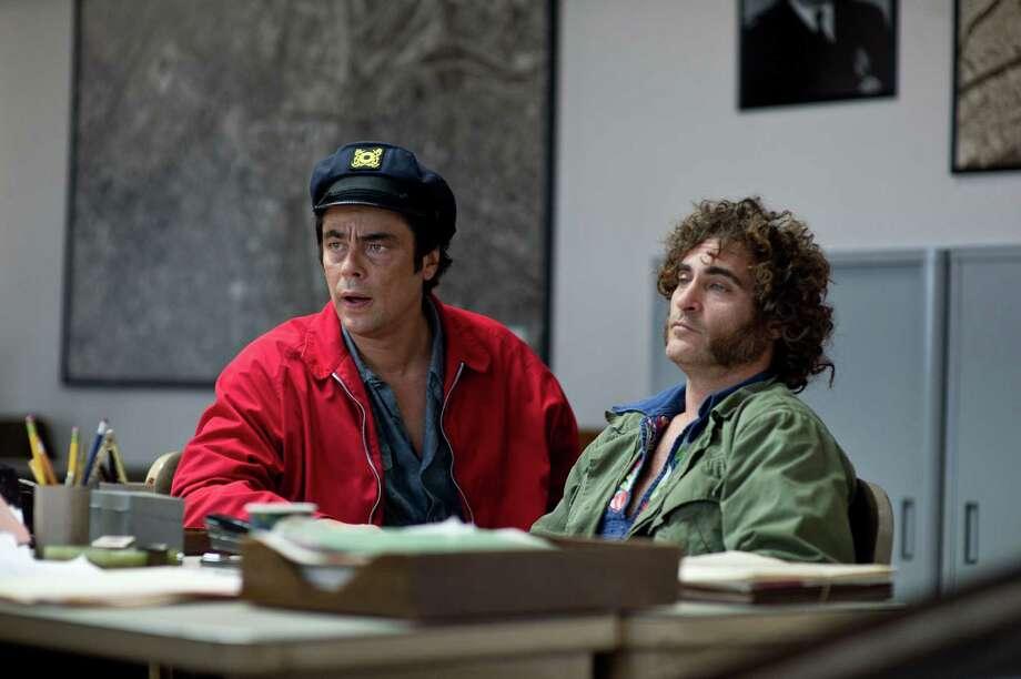 "Benicio Del Toro (left) plays Sauncho Smilax, Esq., and Joaquin Phoenix is Larry ""Doc"" Sportello. Photo: Wilson Webb / Warner Bros. / ONLINE_YES"
