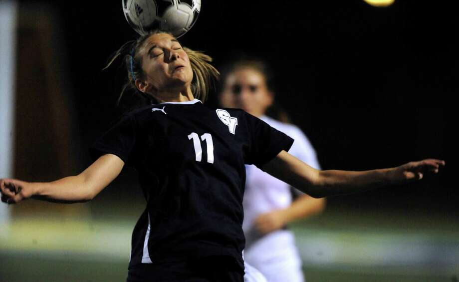 Gabby Rodriguez of Smithson Valley heads the ball during girls soccer action at Clemens on March 23, 2012. Photo: Billy Calzada /San Antonio Express-News / San Antonio Express-News