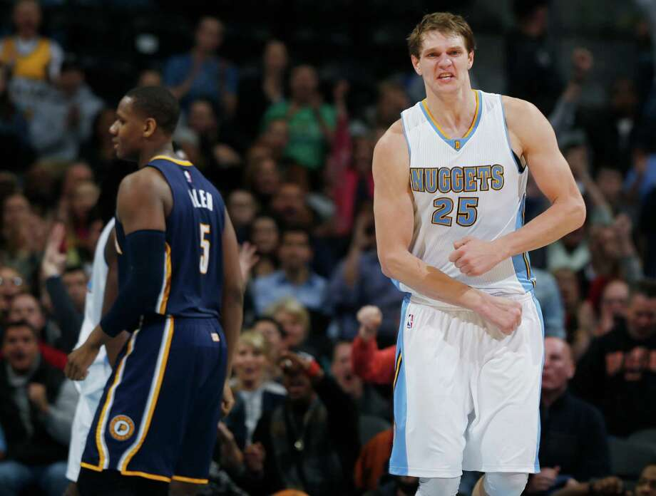 Center Timofey Mozgov (right) was acquired by the Cavaliers in the wake of Anderson Varejao's injury. Photo: David Zalubowski / Associated Press / AP