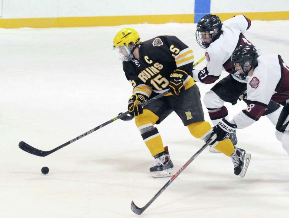 At left, Tommy Dunleavy (#15) of Brunswick School leads a break getting out in front of Loomis Chaffee players, Colin Merrill (#21), top, and Zach Giuttari (#8), bottom, during the boys high school ice hockey game between Brunswick School and Loomis Chaffee School at Brunswick in Greenwich, Conn., Wednesday, Jan 7, 2015. Photo: Bob Luckey / Greenwich Time