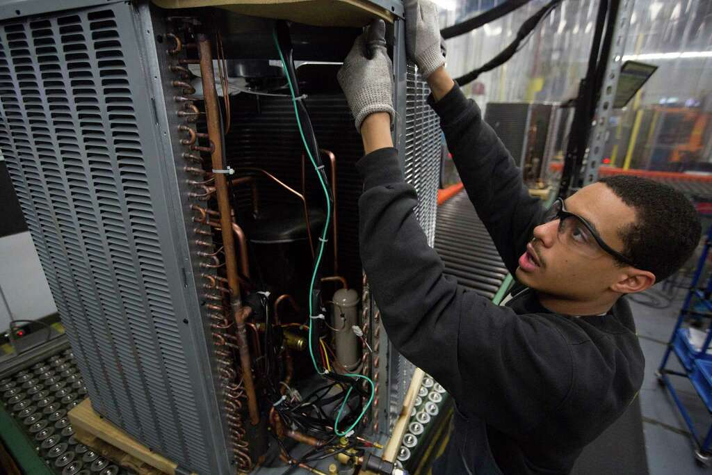 goodman manufacturing. bobby antwine works on an air-conditioning unit at goodman manufacturing facility wednesday, jan u