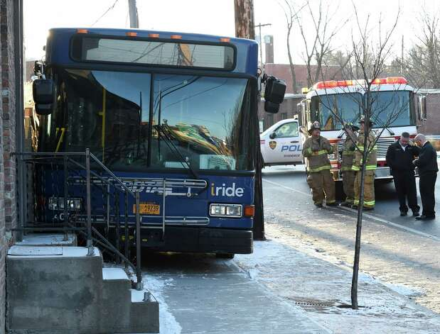 Troy Police are investigating a personal injury accident involving a CDTA bus that lost control and was wedged between a home at 383 Congress Street and a utility pole and sent a number of people to the hospital Wednesday morning Jan. 7, 2015 in Troy, N.Y.        (Skip Dickstein/Times Union) Photo: SKIP DICKSTEIN