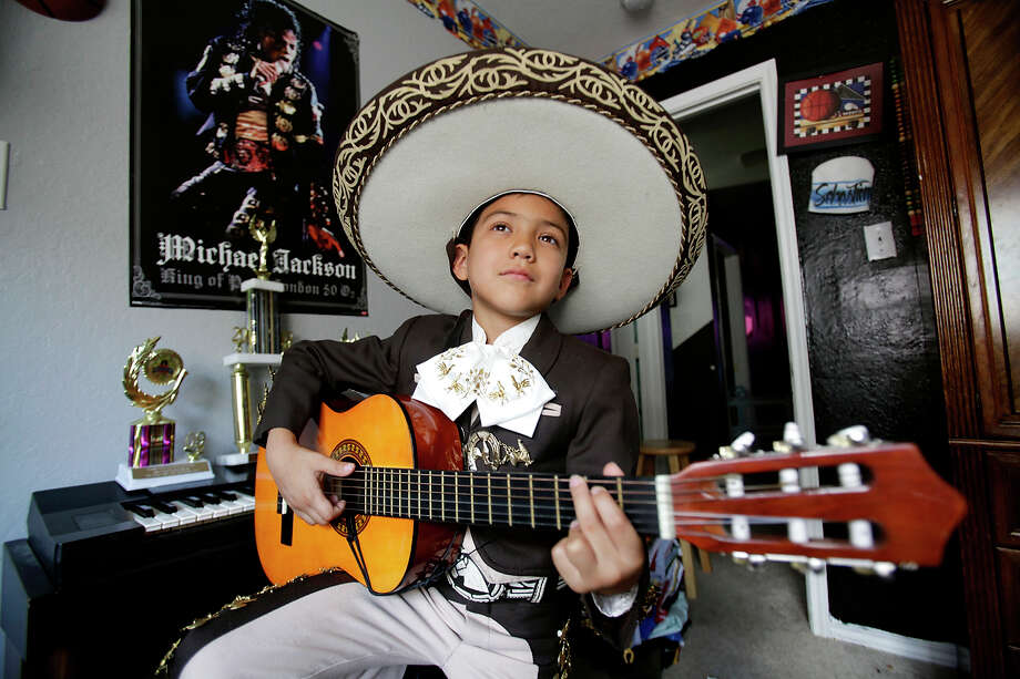 Sebastien E. De La Cruz, 8, or El Charro de Oro as he is also known by, stands in his room for a portrait on July 24, 2010. De La Cruz, who has been singing Mariachi music since he was 5 and has done over 100 live performances, won the 2nd Annual Mariachi Music Fest at Austin City Hall on June 18, 2010. Photo: Ivan Pierre Aguirre, San Antonio Express-News / SAN ANTONIO EXPRESS-NEWS