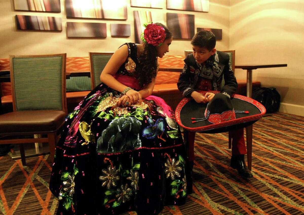 Bryanna Rich, 10 and Sebastien De La Cruz, 9 talk during a a press conference on Nov. 28, 2011, announcing the 17th Annual Mariachi Vargas Extravaganza. Both children performed songs during the press conference.