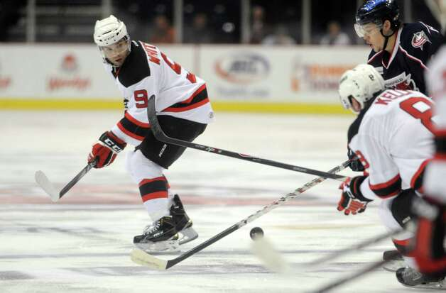Devils Joe Whitney, left, and Dan Kelly move the puck up the ice during their hockey game against Springfield at the Times Union Center on Wednesday Oct. 29, 2014 in Albany, N.Y. (Michael P. Farrell/Times Union) Photo: Michael P. Farrell / 00029212A