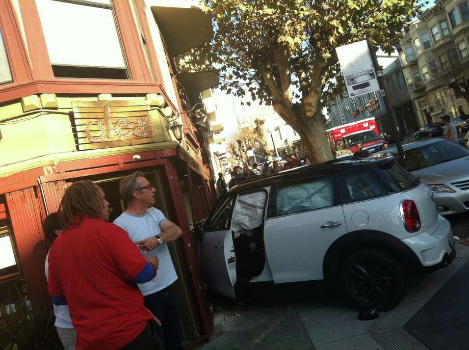 A Mini Cooper crashed into the front of Olea restaurant in Nob Hill, at the corner of California and Larkin streets in San Francisco, on Wednesday. Photo: Viper Kathlyne Markham / Courtesy Of Viper Kathlyne Markh / ONLINE_CHECK