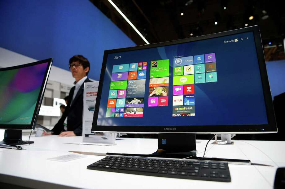 The ATIV One 7 Curved computer is on display at the Samsung booth during the International CES. It's designed to produce a more immersive experience for watching videos or playing games. Photo: John Locher /Associated Press / AP
