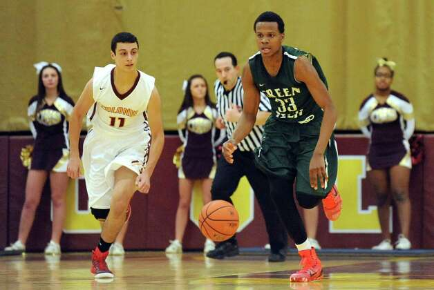 Green Tech's Anquan Mclean, right, controls the ball as Colonie's Mike Ziamandanis defends during their game in the Colonie Basketball Tournament final on Saturday, Dec. 27, 2014, at Colonie High in Colonie, N.Y. (Cindy Schultz / Times Union) Photo: Cindy Schultz / 00029996A