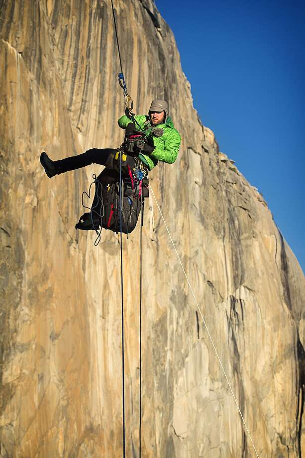 Tommy Caldwell hangs suspended in mid-air while using a video camera to document his and climbing partner Kevin Jorgenson's ascent of the Dawn Wall of El Capitan in Yosemite National Park, California, on Saturday, January 3, 2015. Photo: Corey Rich/Aurora Photos