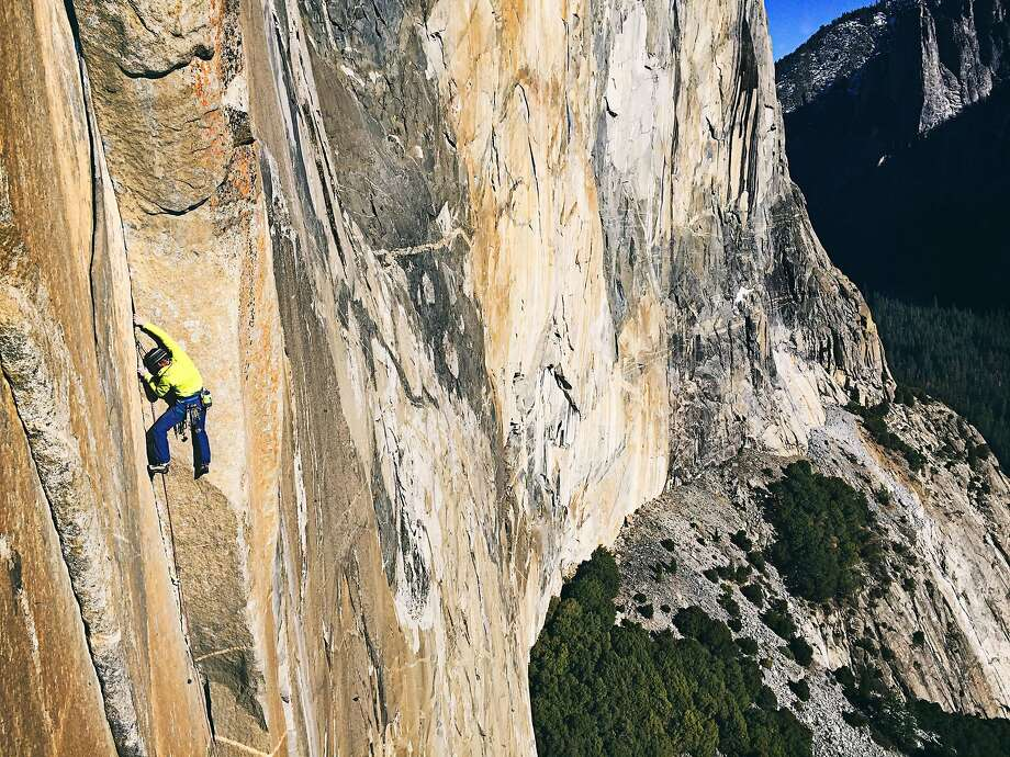 Climber Tommy Caldwell ascends the Dawn Wall of El Capitan in Yosemite National Park, California on Wednesday, December 31, 2014. Photo: Brett Lowell / Big UP Production
